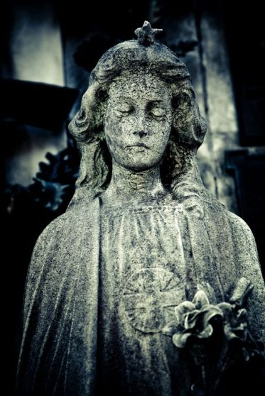 statue depicting a sad woman in recoleta cemetery, buenos aires - argentina